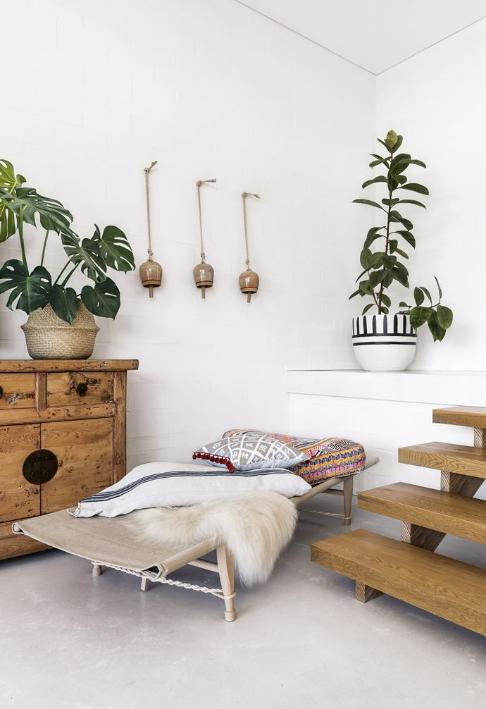 """**Living area** The Swedish canvas daybed from Dunlin displays an array of loved textiles. Bells by Michele Quan, mquan-studio.myshopify.com. Plant and pot, [Little Leaf Co.](https://www.littleleafco.com.au/