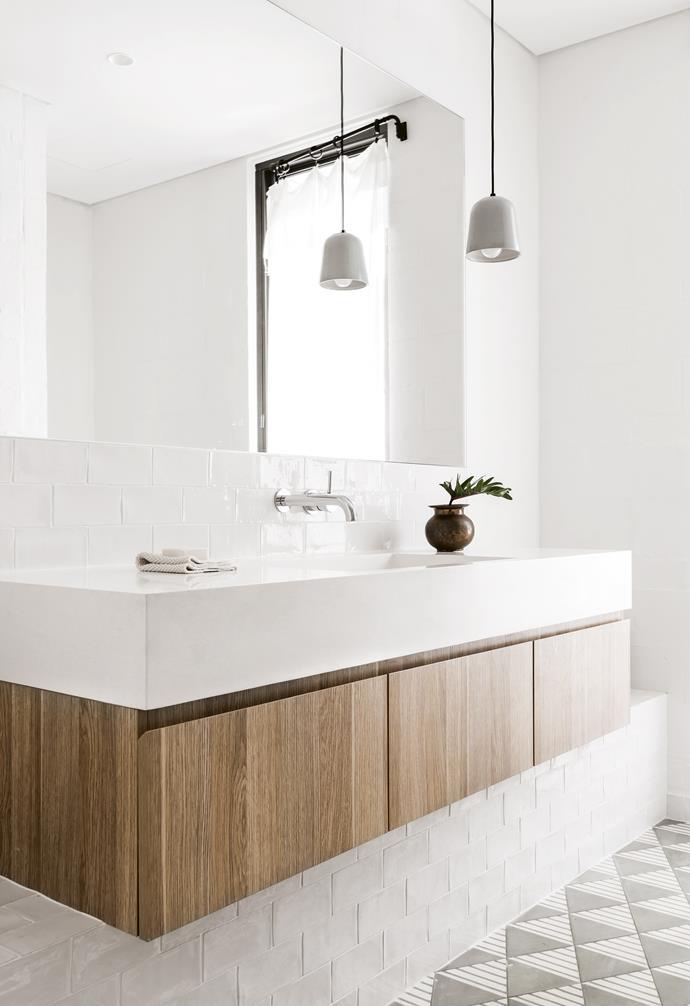 "**Kids' bathroom** Contrasting tiles continue the sense of texture throughout. Tiles, [Popham Design](http://pophamdesign.com/|target=""_blank""). White tiles, [Surface Gallery](http://surfacegallery.com.au/|target=""_blank""). Vanity sink, [Apaiser](https://www.apaiser.com/|target=""_blank""). Taps, [Astra Walker](http://www.astrawalker.com.au/|target=""_blank""). Cabinetry, Benchmark cabinets, (08) 9371 0499."