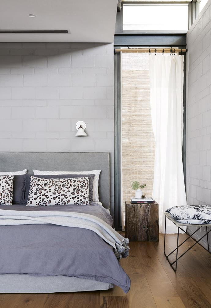 """**Master bedroom** This space features cool greys and simple details. Wall light, Schoolhouse, schoolhouse.com. Vintage canvas side table and bedside table, [Kartique](https://www.kartique.com.au/