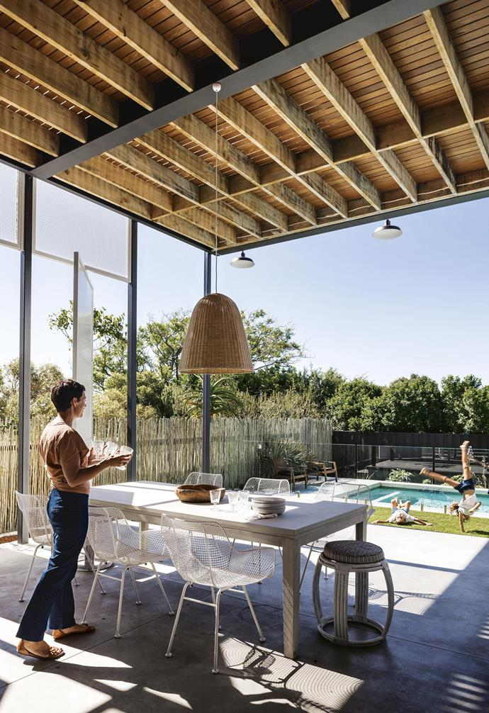 """**Outdoor dining** Anna and Paul love to entertain while the kids play. The upper deck provides dappled sunlight. White mesh chairs, [Lostine](https://lostine.com/