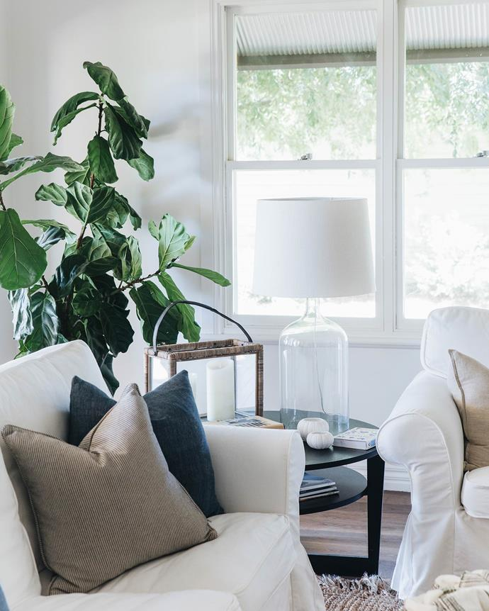 """In the lounge room, IKEA sofas are styled with cushions from [Once Was Lost](https://www.oncewaslost.com/