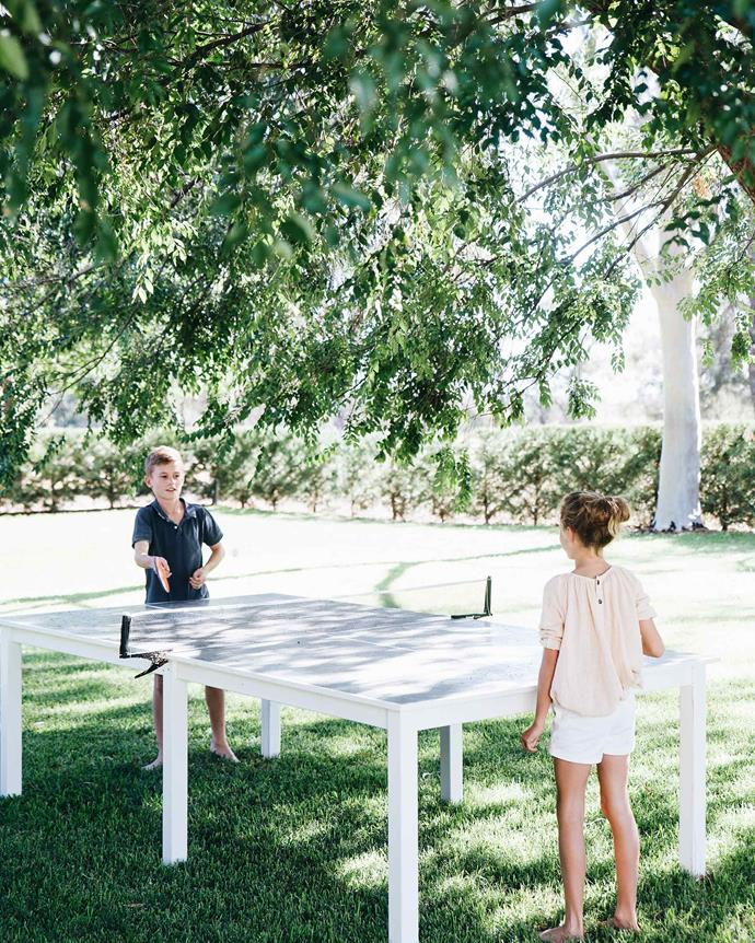 Scott made the tennis table in the garden. *Photography: Abbie Melle*