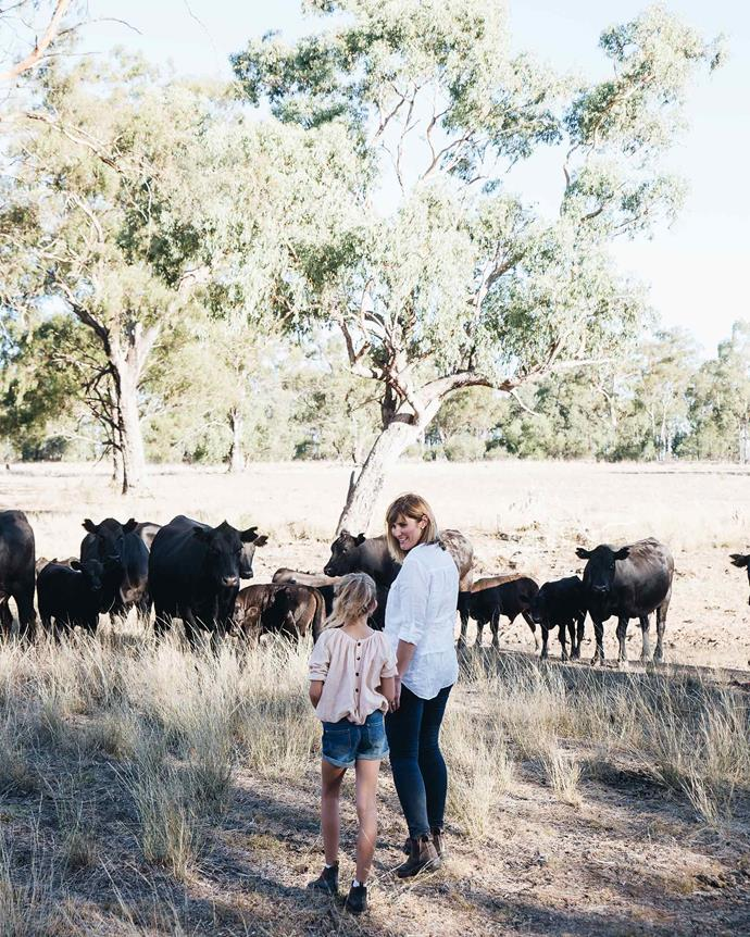 Sally checking on the family's Angus cattle with Lilla. *Photography: Abbie Melle*