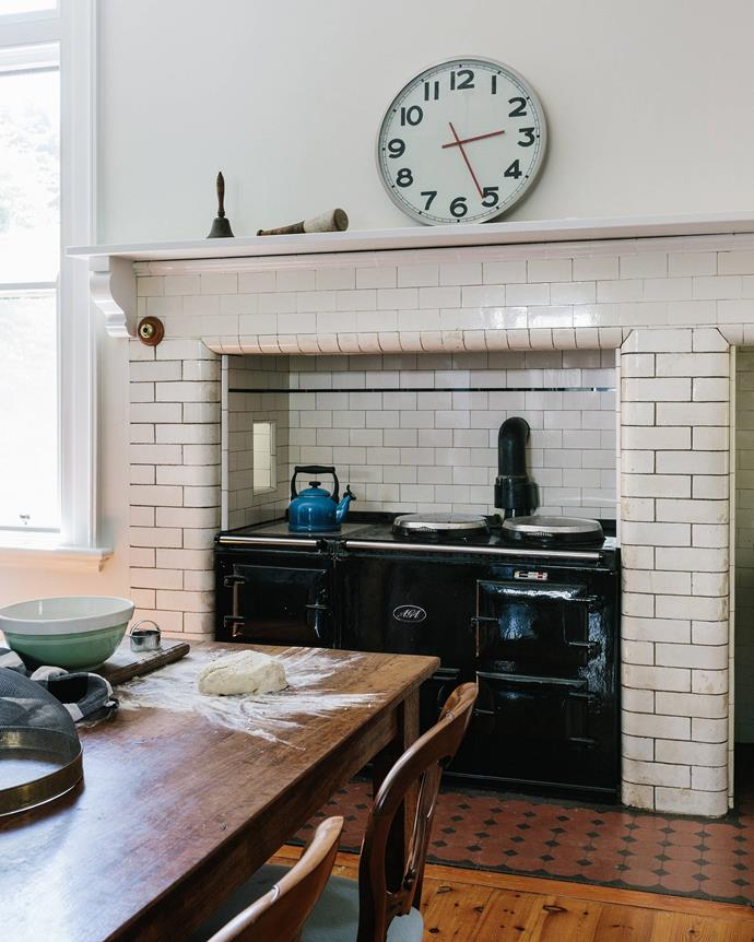 The couple freshened up the 1910 kitchen with a coat of Dulux Antique White USA paint. The table was custom-made with red gum from a friend's property.