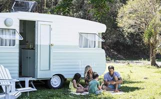 Michael and Carlene with their kids and renovated vintage caravan