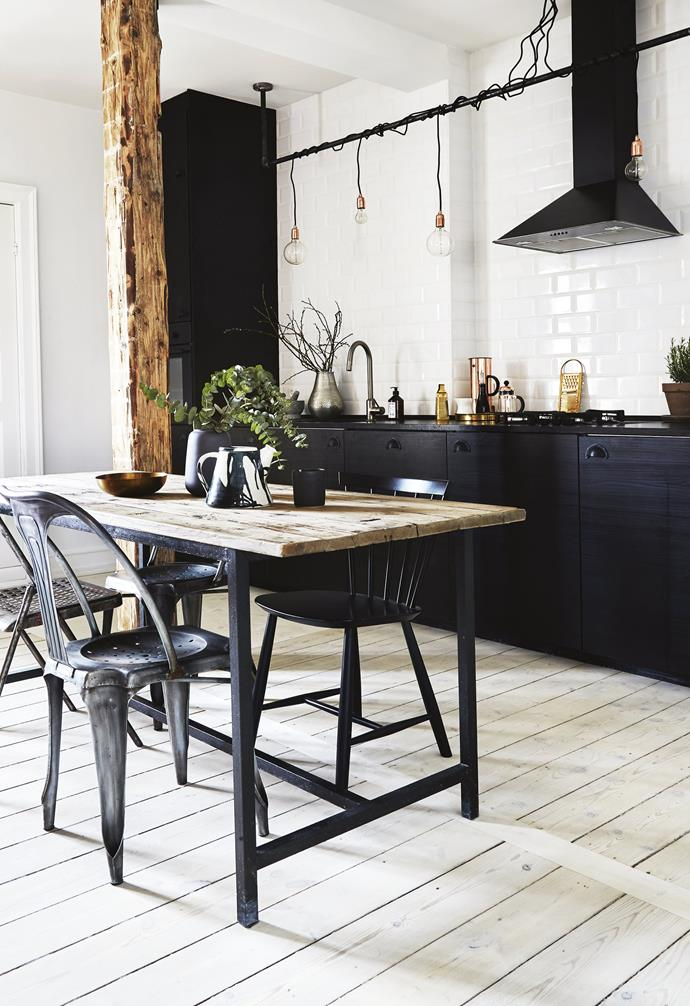 """**Kitchen and dining area** Raw timber surfaces, exposed brickwork and subway tiles emphasise the New York feel of the apartment. The black [IKEA](https://www.ikea.com/