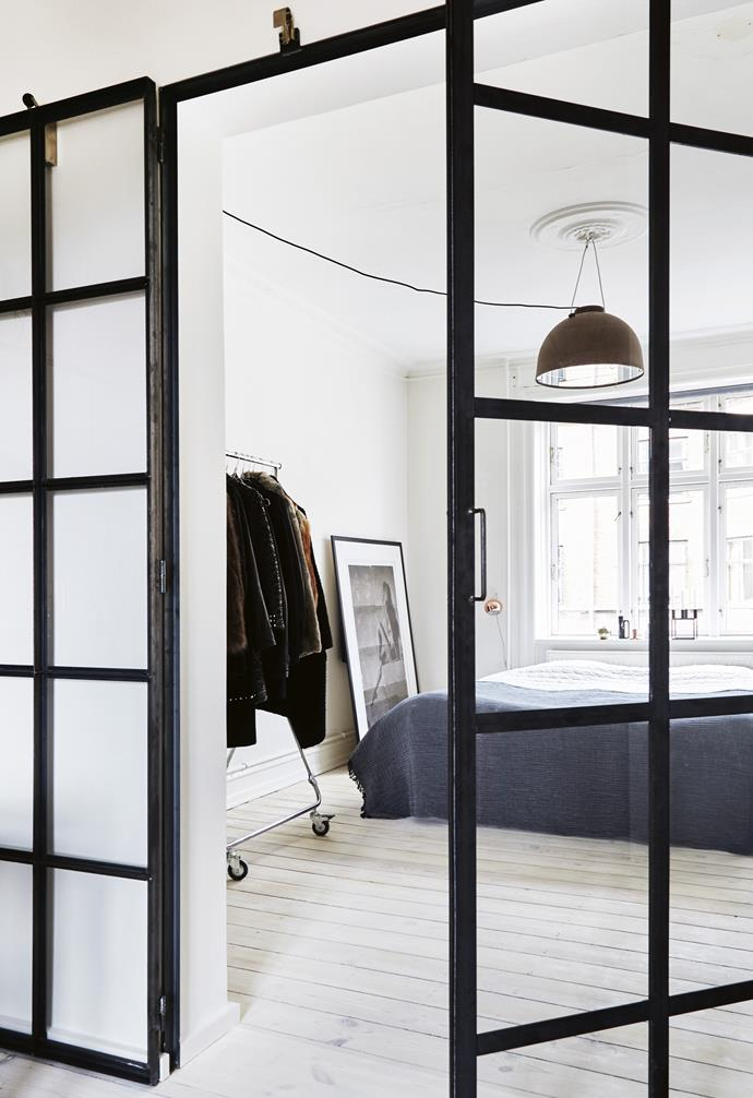 **Bedroom** Glass windows and doors flood the home with sunlight.