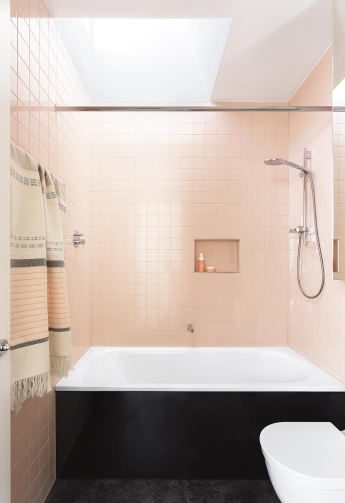 """Dusty pink tiles from [Classic Ceramics](http://www.classicceramics.com.au/) make this the ultimate girls' bathroom. A mirrored shaving cabinet and skylight keep the small spot feeling bright and open. """"It allows the light to filter down onto the beautiful tiles,"""" says architect Monique. Photography by Martina Gemmola. Styling by Ruth Welsby. Photographer: Martina Gemmola, Stylist: Ruth Welsby"""
