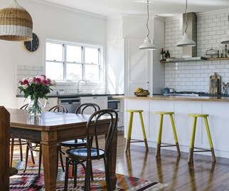Modern country kitchen with timber dining table and yellow bar stools