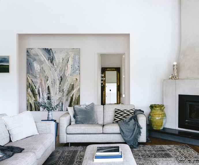 A simple sofa by [King Furniture](https://www.kingliving.com.au/furniture) is complemented by a Guy Maestri painting, as well as textured cushions and throws. The smaller artwork is from the local [John Lloyd](http://johnlloydgallery.com.au/) gallery. A vase from [Market Import](http://www.marketimport.com.au/) in Armidale adds a pop of colour while candles from [Kabinett](http://kabinett.com.au/) adorn the mantelpiece. | Photo: Marnie Hawson