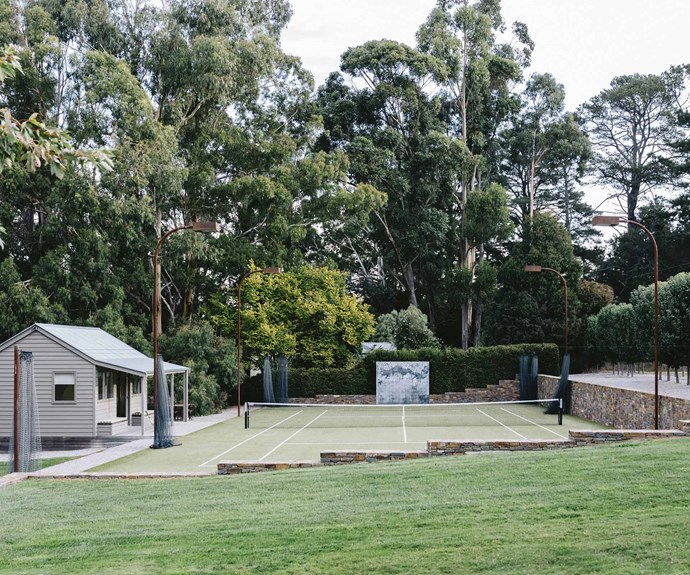 While taking a year to extend the property, the couple also bought the block next door to make their own tree-lined tennis court and pavilion. The court lights were made by [Tait Decorative Iron](http://www.decorativeiron.com.au/). | Photo: Marnie Hawson