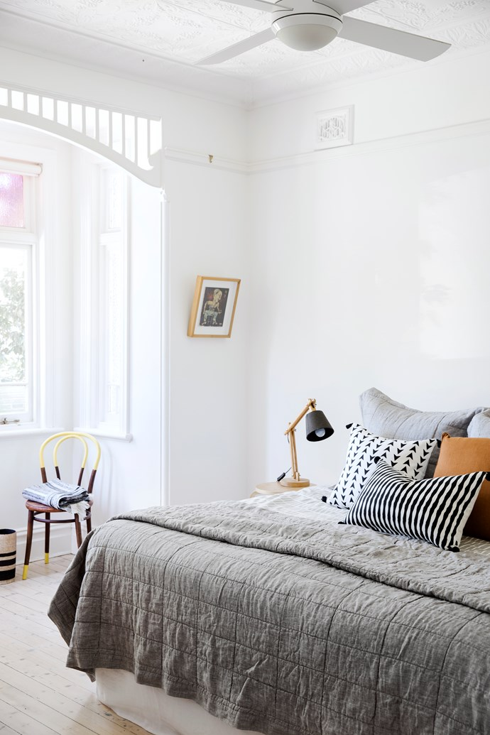"""Rather than pendant lights, Vanessa opted for uplights (with lamps for reading) in order to highlight the detail in the original pressed-metal ceiling. Australian House & Garden 'Katoomba' quilt cover, from [Myer](https://fave.co/2xhylkI