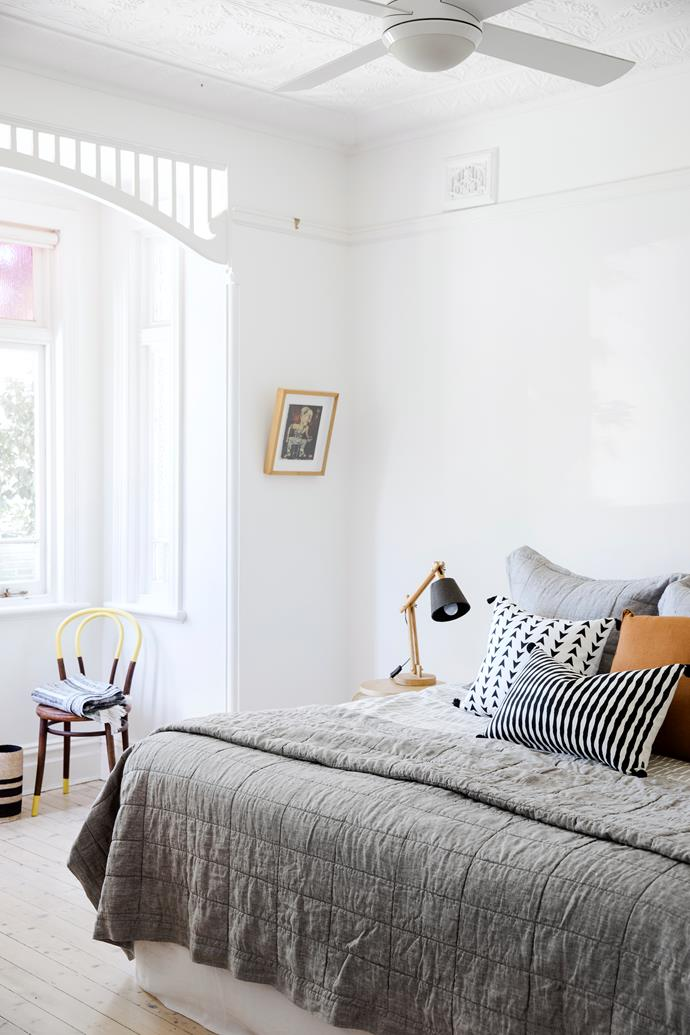 "Rather than pendant lights, Vanessa opted for uplights (with lamps for reading) in order to highlight the detail in the original pressed-metal ceiling. Australian House & Garden 'Katoomba' quilt cover, from [Myer](https://fave.co/2xhylkI|target=""_blank""