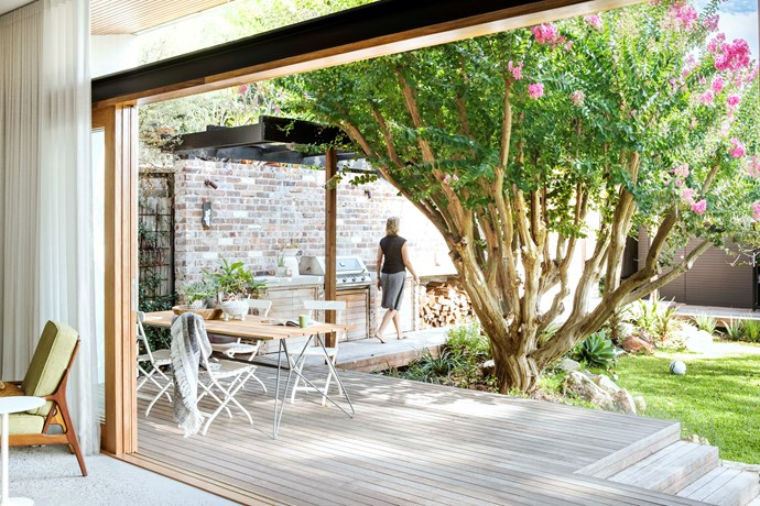 Owner-architect Vanessa Wegner treads the boards between her home and studio. The boundary wall is made from bricks recycled from a demolished extension.