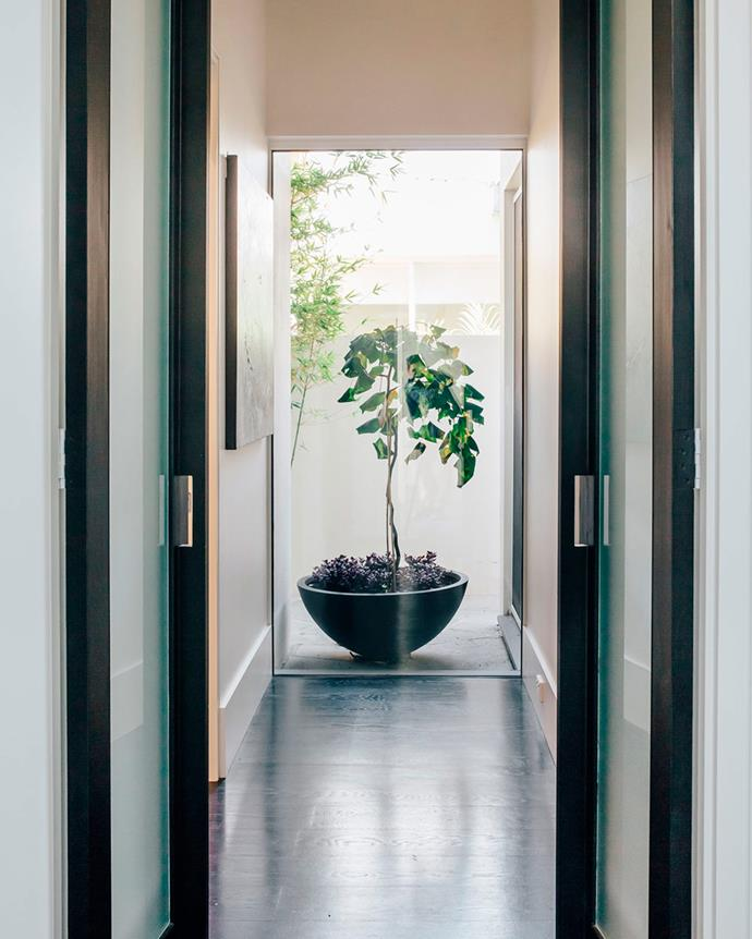 """The entrance into the bedroom from the foyer. On the left is the dressing room and ensuite, with the master bedroom on the right. """"It's all built into one space, with windows to let plenty of light in with doors to close the rooms off and panels to allow privacy,"""" says David.   *Photo: Christopher Morrison*"""