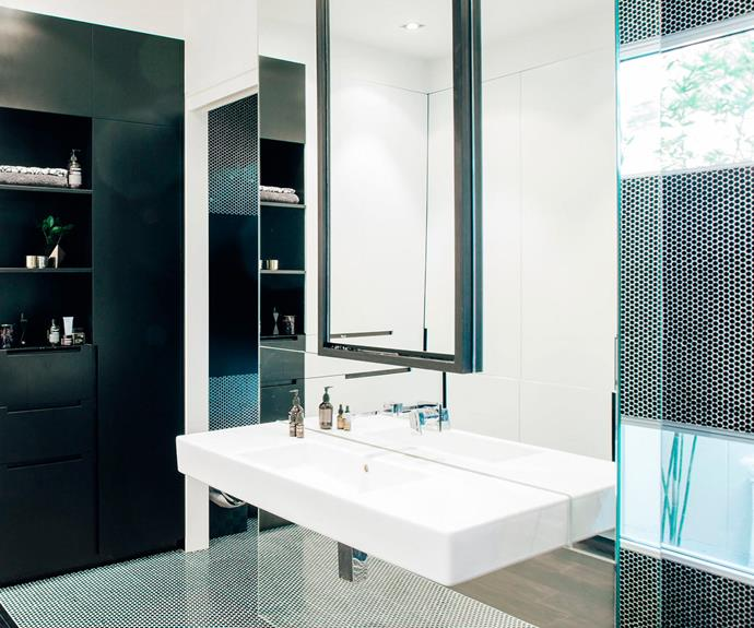 Black pennyrounds add depth to the ensuite bathroom. | *Photo: Christopher Morrison*