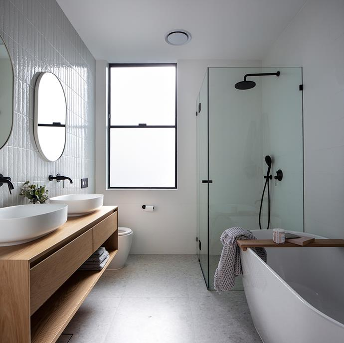 Vertical lines feature throughout Catherine's home, seen here in her choice of bathroom tiles.