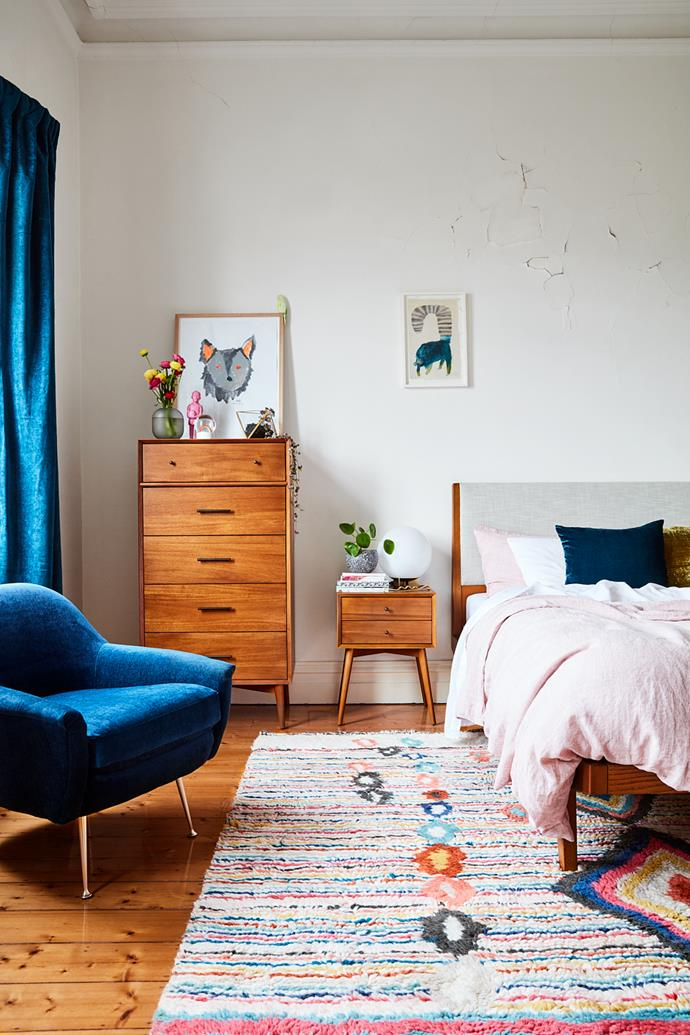 """""""I always wanted to see what our bedroom looked like with velvet curtains – now they're up I love them so much. They suit the room perfectly. The Charm rug is also a joy,"""" Beci continues, """"Having the chair in our room feels very grown up indeed, I love the warmth of the rusty colour too."""""""