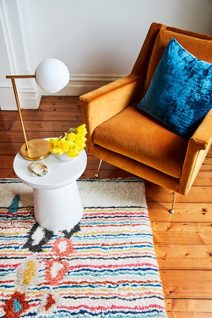 Underneath the mustard armchair, the quirky rug adds a tactile contrast to the timber floorboards of the space. The pops of colour on the rug reference Beci's love of colour and her own style.