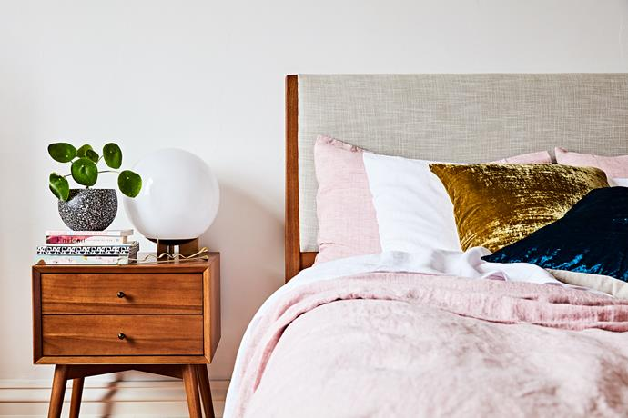 """The mid-century modern style bedside table echoes the timber floorboards of the room, and the timber [bedhead](http://www.homestolove.com.au/bedhead-styles-we-want-to-wake-up-with-17215