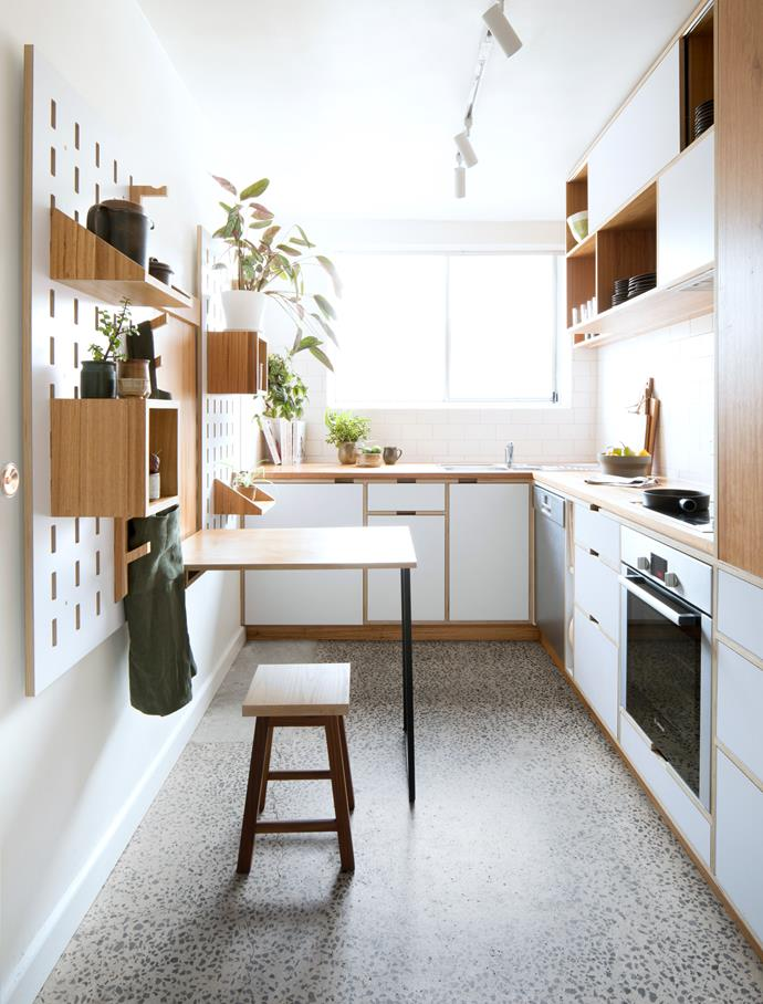 """The fold-up plywood table with blackbutt-veneer top measures a generous 800x600mm. """"We love this feature because a regular table would have closed in the space,"""" says Will. """"Anna eats breakfast here and often uses it as a workspace."""" *Photo:* Shania Shegedyn"""
