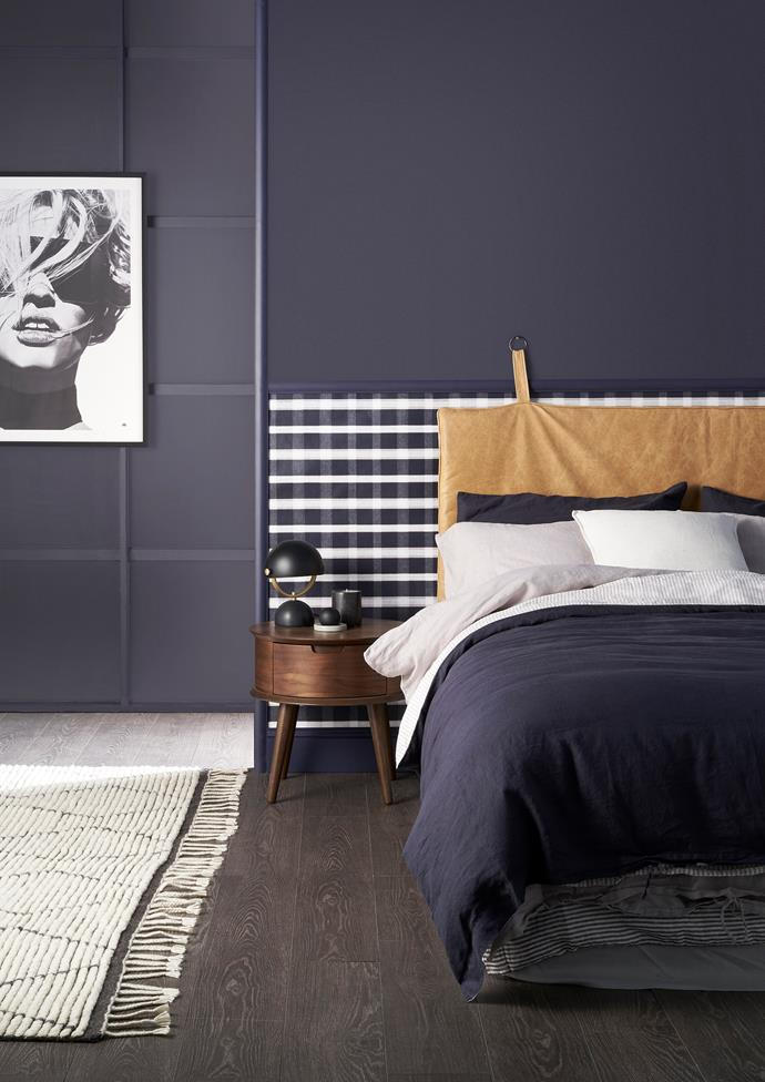 A feature wall in Taubmans Black Flame creates a cosy and cocooning atmosphere in this bedroom.