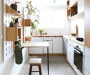 Bespoke, budget-friendly cabinetry transforms a compact apartment kitchen