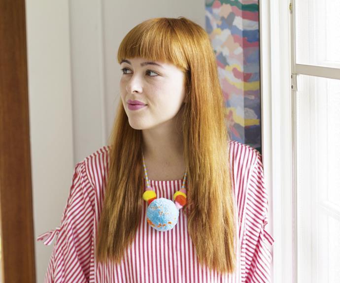 **Pom-pom party** Rachel wears one of her pom-pom necklace designs.