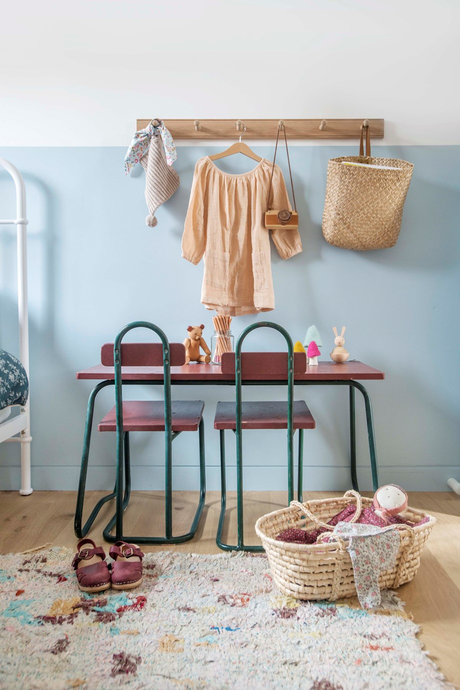 Create a play space within your child's bedroom using a small desk and chairs, wall hooks and storage baskets. A cosy, colourful rug ties it all together.