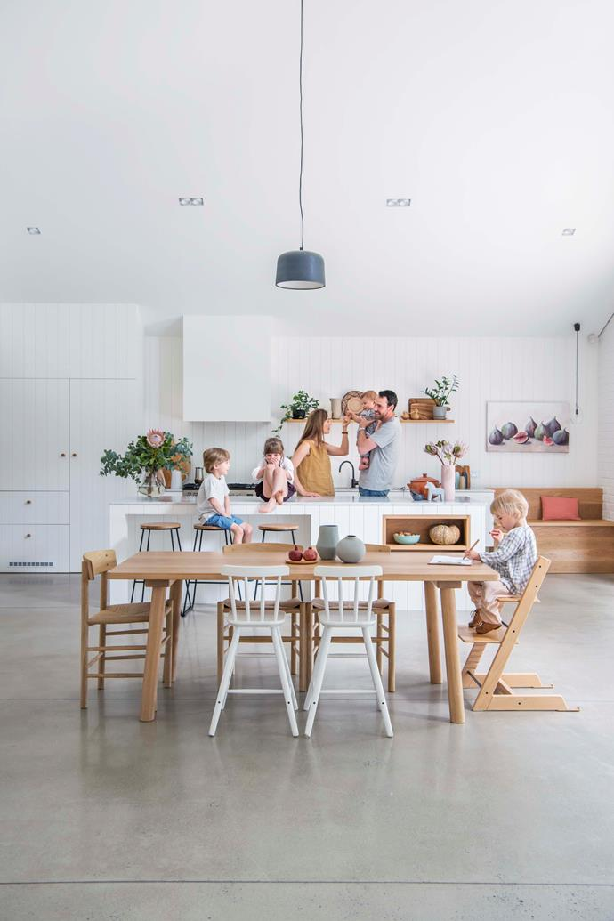 This family space has a practical concrete floor. The benchtop is marble.