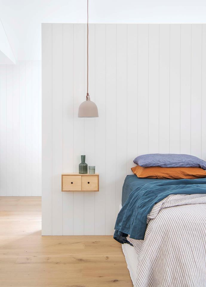 Next to the bed, the 'Little Nest' storage cabinet from Plyroom is just the right size for the cabin-inspired dividing wall.