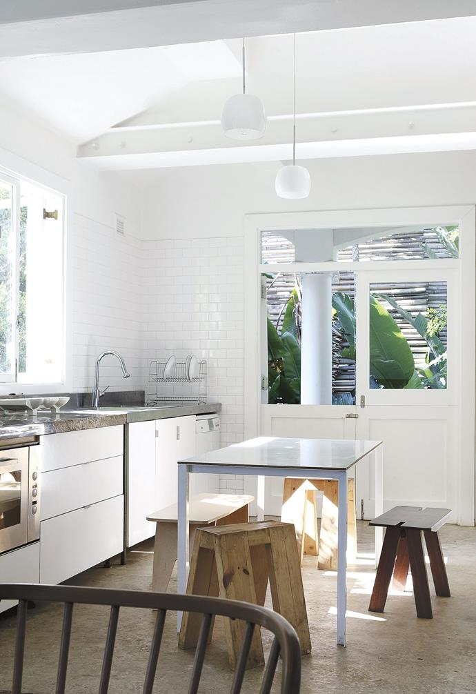 **Kitchen** Sunlight fills this area of the home, ensuring the kitchen is a joy to be in throughout the day. The table and chairs are in the simple forms and natural materials that Rick favours.