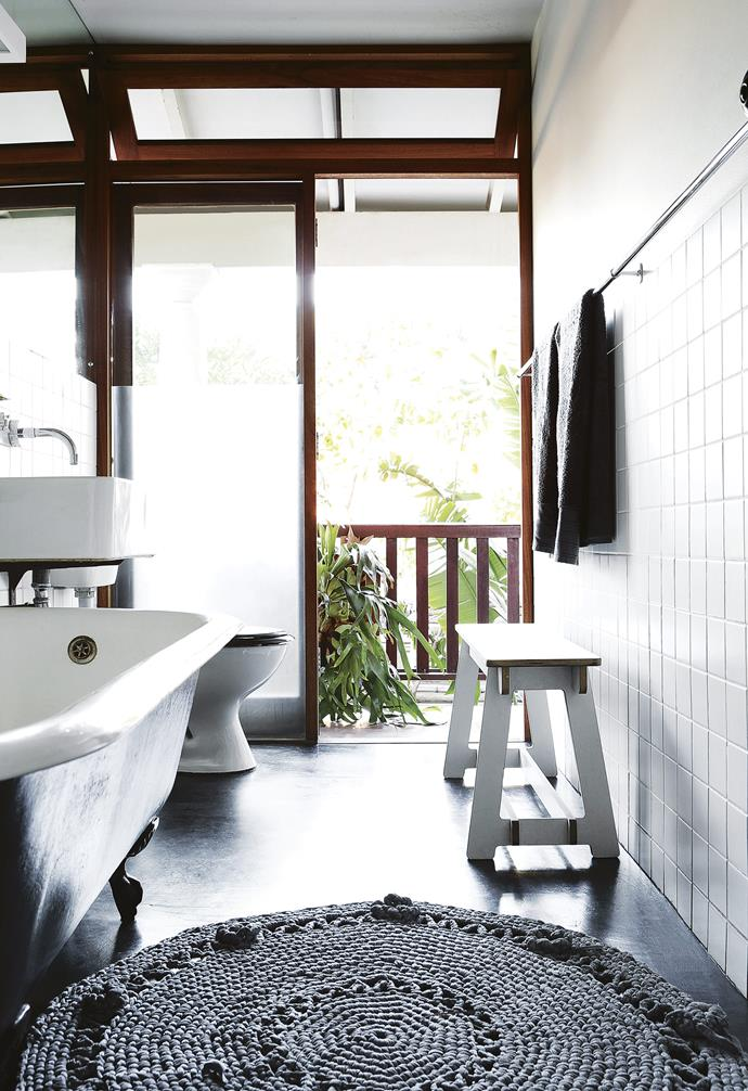 **Bathroom** The claw-foot tub looks out to the lush greenery over the balcony. A crochet mat by Angela's Shaw Sisters Design Collective provides a soft landing underfoot.