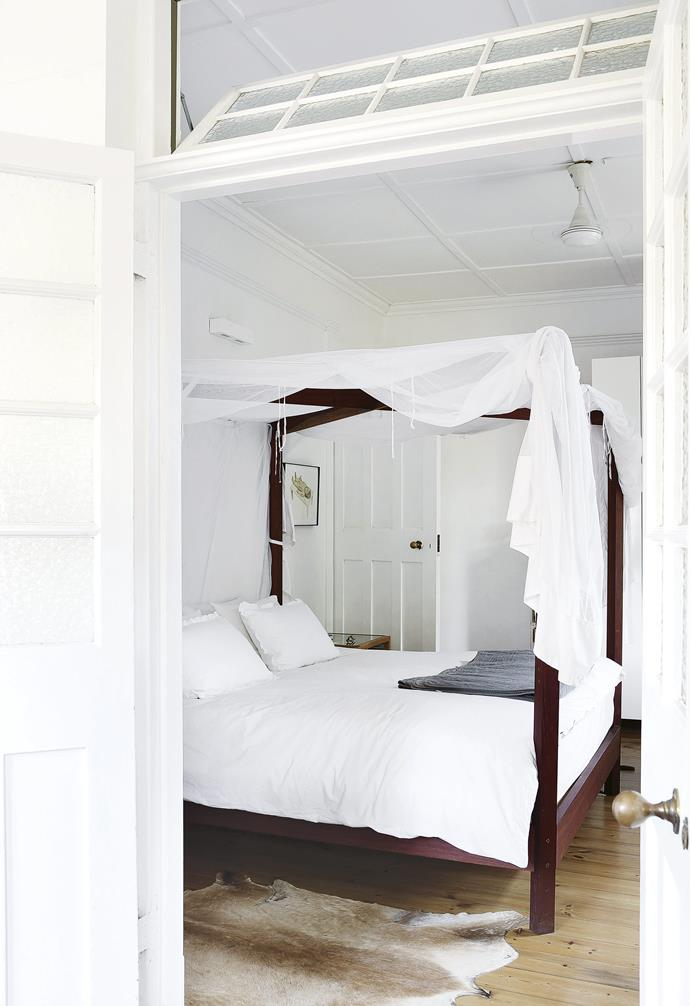 **Master bedroom** French doors allow plenty of air to flow into the space. The four-poster bed echoes the architectural restraint found in the rest of the home. Artwork: *Caesarean Section* by Claudette Schiffer