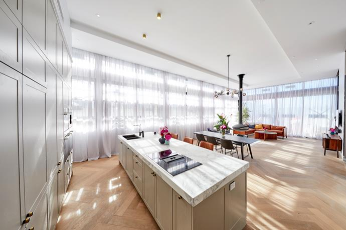 Jess and Norm's penthouse enjoys four-metre high ceilings and plenty of natural light.