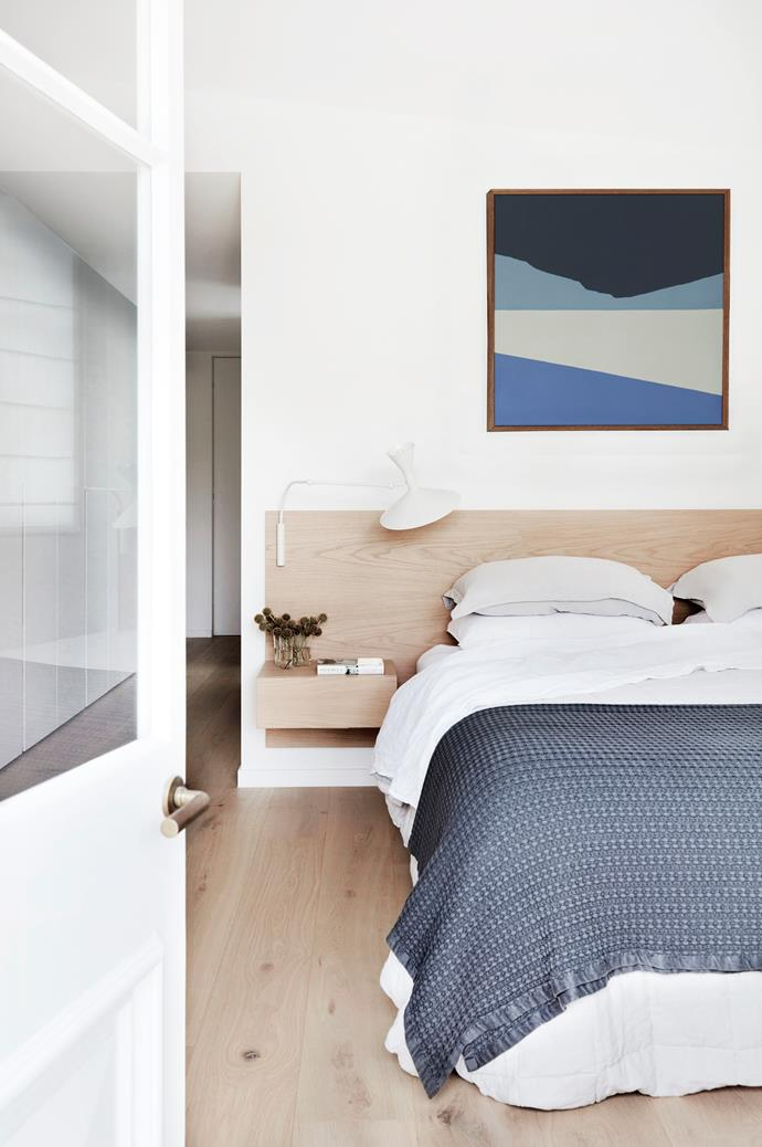 Custom bedhead by Saltwater Joinery. Nemo 'Lampe De Marseille' wall light by Le Corbusier from Cult. Bedding by Bemboka.