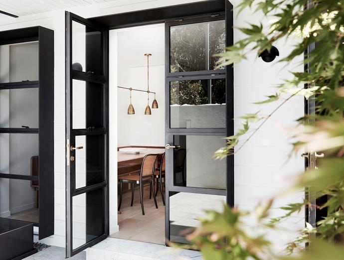 Steel French doors lead to the courtyard.