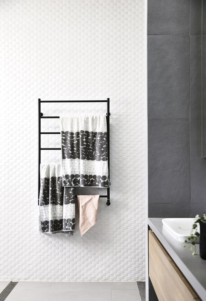 """**Textural towels** If adding bold patterns on your walls or floors is too big of a commitment, opt for vibrant bath sheets, hand towels or bath mats. The temporary nature of [towels](http://www.homestolove.com.au/from-beach-to-bath-what-to-look-for-in-a-towel-10523