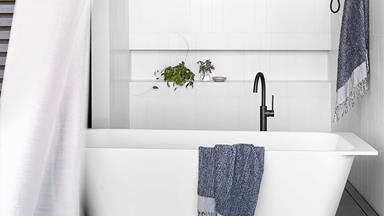 A calming white bathroom with contemporary coastal feel