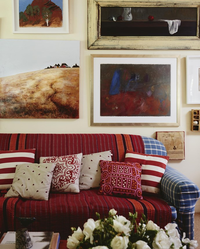 Above the cushion-strewn sofa hang Henry's painting *Arkaroola* (top left), *The Blue Jug* by Elissa Bennett (bottom right) and Annie's painting of the local landscape (bottom left).