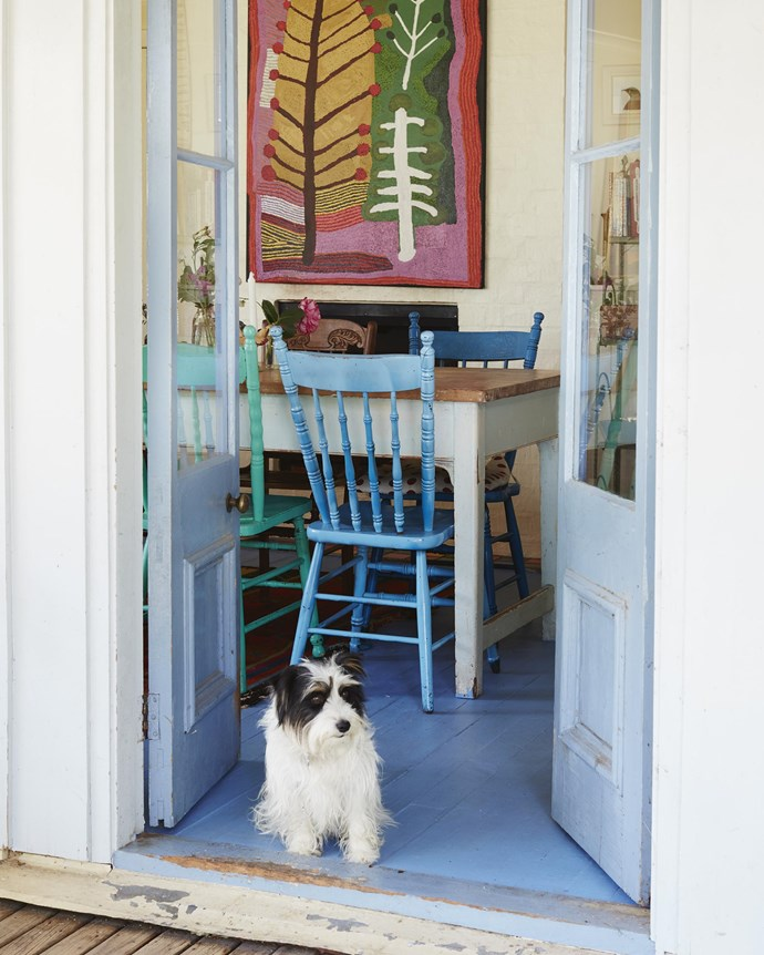 Annie and Henry's long-haired Jack Russell terrier, Maggie, in the dining area. A Ray Ken painting from Alcastan Gallery, Melbourne, adorns the wall.