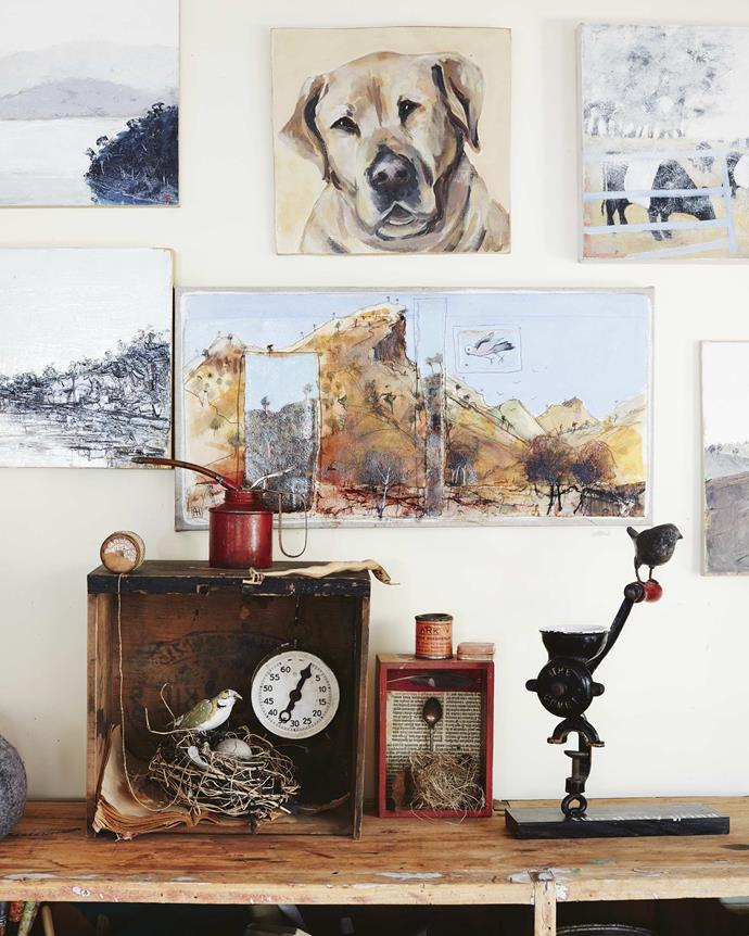 This selection of Annie's artwork includes a portrait of Harry, the family's beloved late labrador, and a sculpture called *The Daily Grind*.
