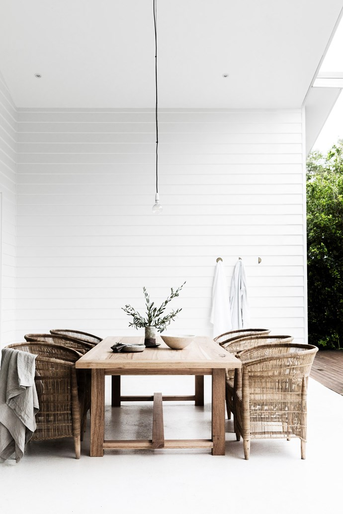 "Family and friends regularly kick back around the outdoor table by Sheoak Design on chairs from MCM House. The [Pop & Scott](https://www.popandscott.com/|target=""_blank""