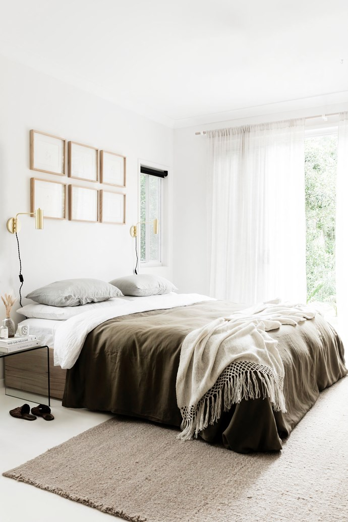 "Lara's favourite piece of furniture is her timber bedframe. ""It was custom-made for us by our friends at Sheoak Design,"" she tells. The bedding is a mix from [In Bed](https://inbedstore.com/