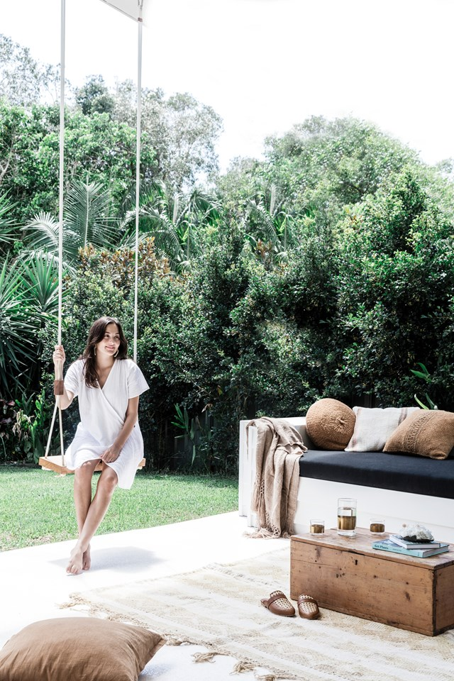 "When it's time to unwind, the owners of this beautiful [Byron Bay home](https://www.homestolove.com.au/a-byron-bay-home-filled-with-handcrafted-finds-19045|target=""_blank"") get to choose between hanging about on a cute wooden swing from Pop & Scott or soaking up the sunshine from a custom-built daybed."