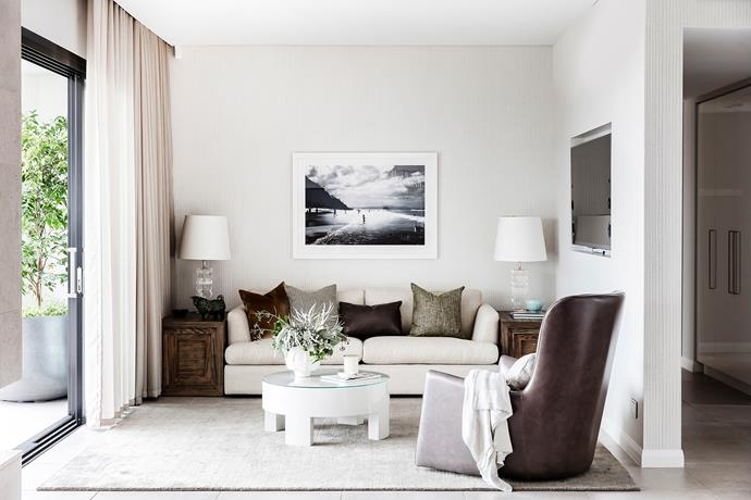 The artwork is a photograph Matthew took of a beach in Byron Bay. Sofa, from Arthur G. Coffee table and side tables, all Matthew Barnes Interior Design.