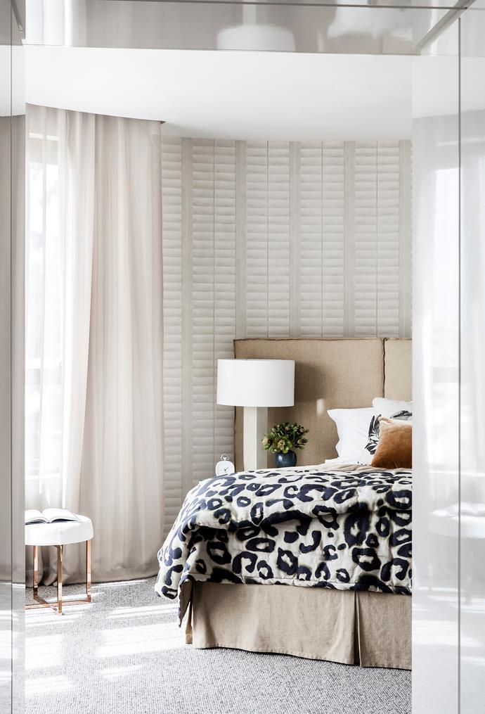 The challenge of a curved wall was addressed with quirky plantation shutter-look wallpaper. Bedhead and linen, Matthew Barnes Interior Design. Dedar curtain fabric, South Pacific Fabrics. Lamp, from Coco Republic. '