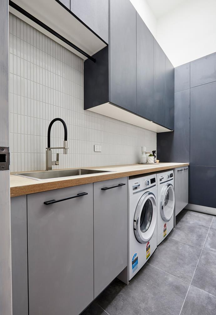 **Bianca and Carla** The generous laundry makes a statement with dark cabinetry.