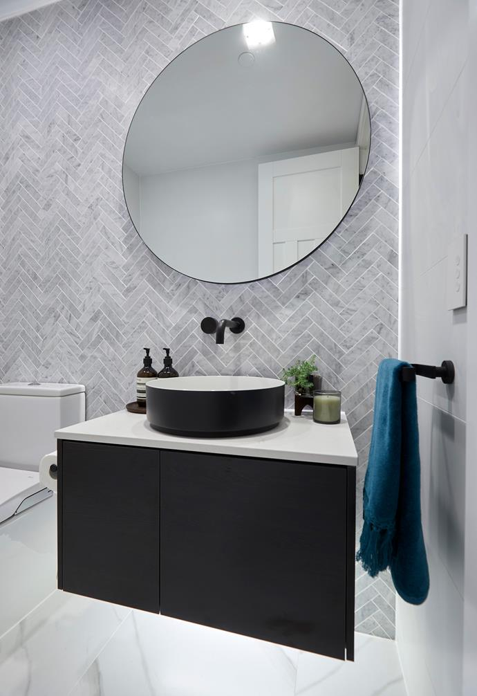 "**Kerrie and Spence** The herringbone tiles on the wall echoes the tiling in the ensuite and master bathroom with Shaynna saying it felt like the couple were ""tying everything up with a bow""."