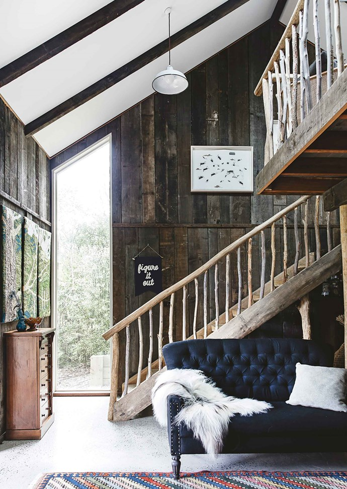 Balustrades and railings were made from branches sourced on the property, with salvaged 80-year-old Oregon boards lining the walls.